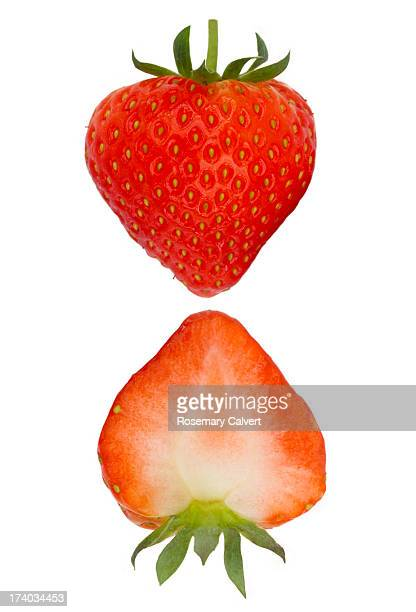 two halves of fresh, ripe strawberry - strawberry stock pictures, royalty-free photos & images