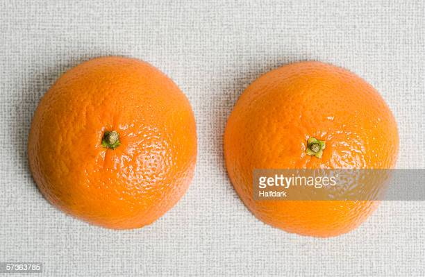 Two halves on an orange on a table