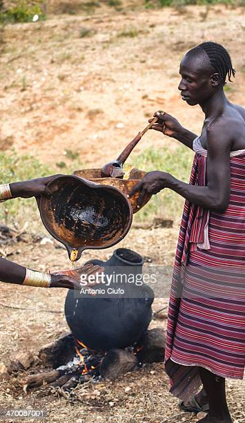 CONTENT] Two Hamer are preparing a drink made from wheat during the bull jump ceremony The Hamer are a tribal people in southwestern Ethiopia Are...