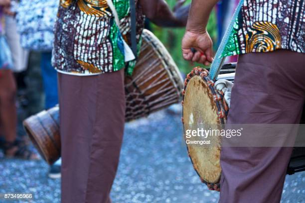 two hand drummers - gwengoat stock pictures, royalty-free photos & images