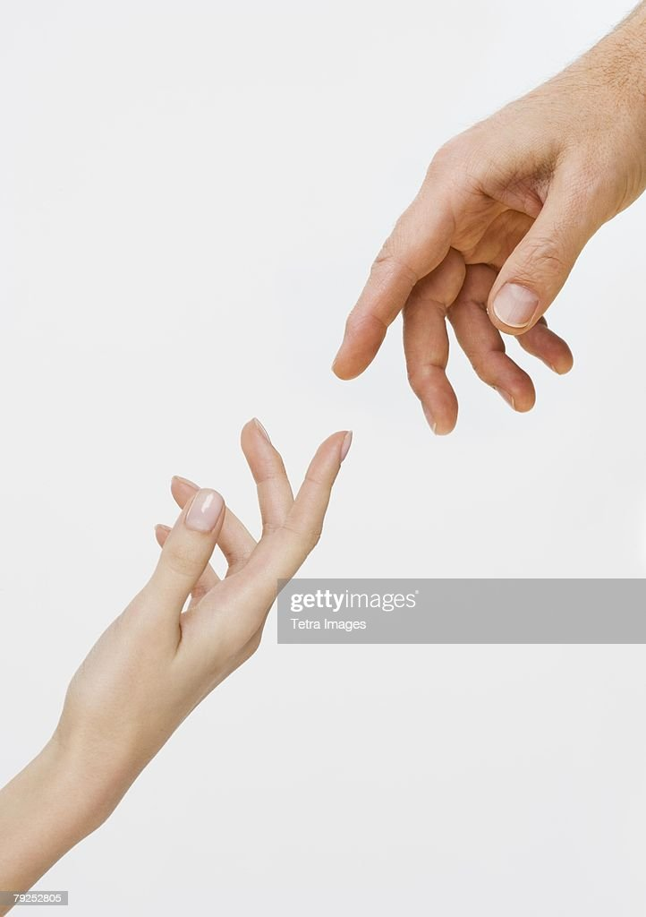 Two hands about to touch : Stock Photo