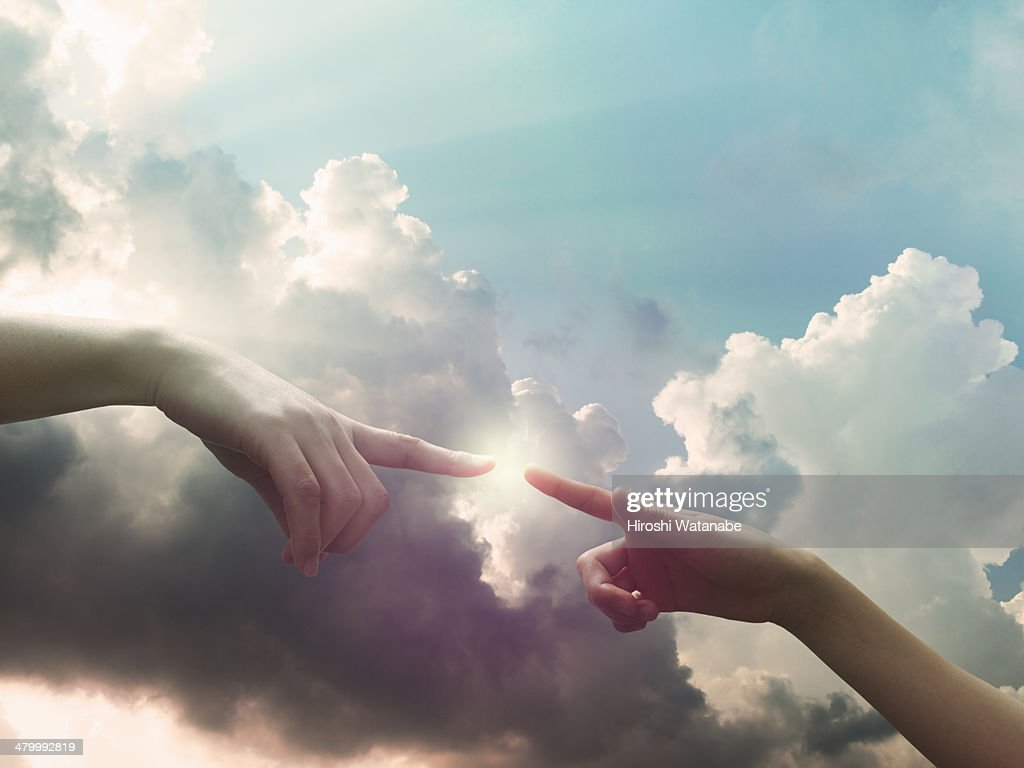 Two hands are connecting in the sky : Stock Photo