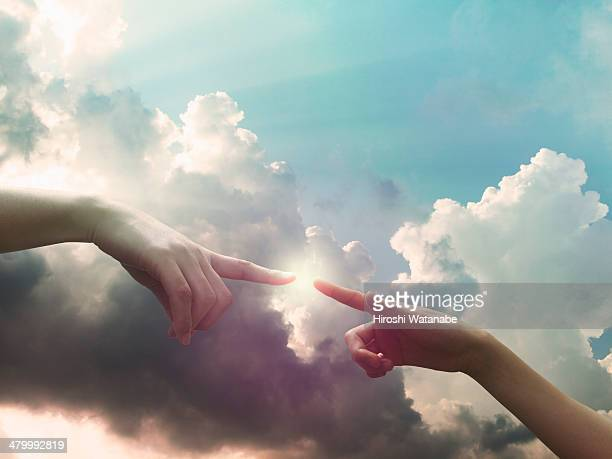 Two hands are connecting in the sky
