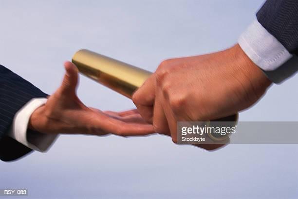 two hands exchanging baton - stab stock-fotos und bilder