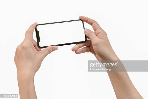 two hands holding big screen smart phone - horizontal imagens e fotografias de stock