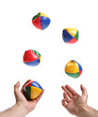 Two hands juggling set of five colorful bean balls
