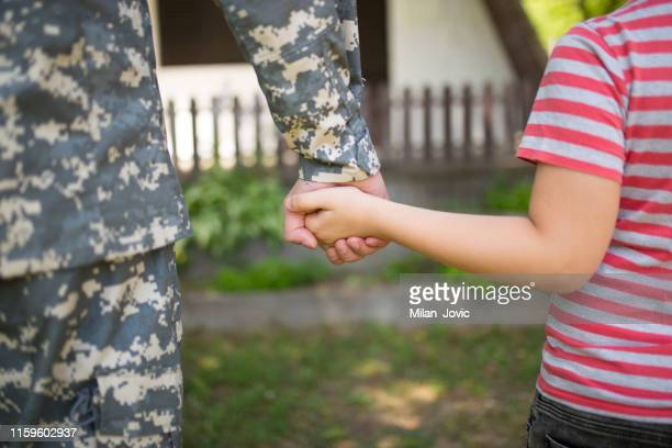 two hands of one family - father and child together - military stock pictures, royalty-free photos & images