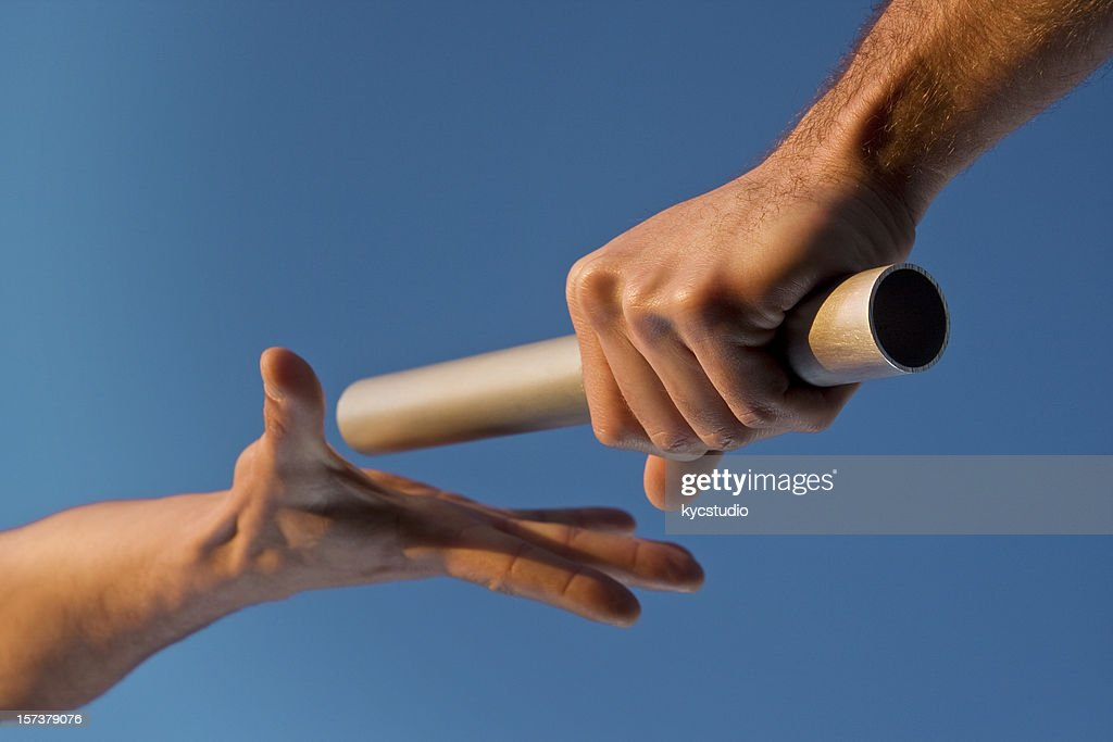 Two Hands Passing Relay Baton Race : Stock Photo