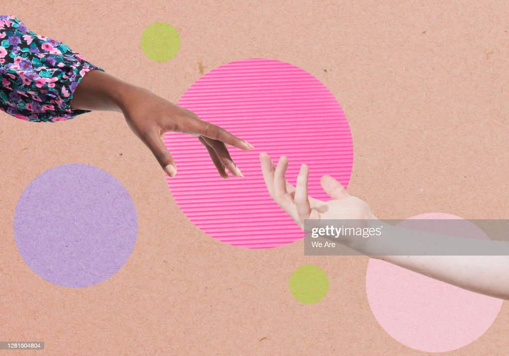 two hands reaching for each other : Stock Photo