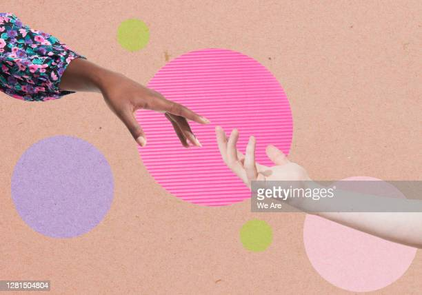 two hands reaching for each other - reaching stock pictures, royalty-free photos & images