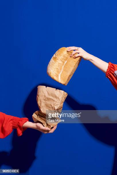 two hands with loaf of bread - loaf of bread stock pictures, royalty-free photos & images
