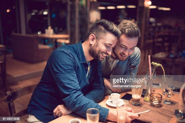 Two Handsome Friends Enjoy on Double Date in a Bar