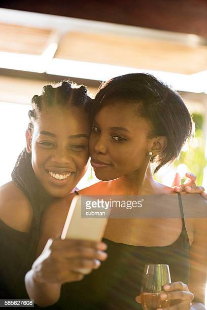 Two Happy African Women Posing For a Selfie