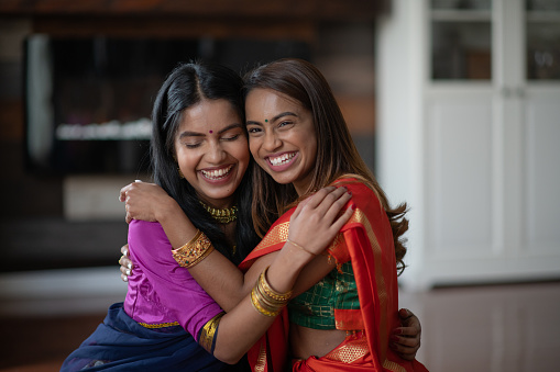 Two (2) Happy and Attractive Indian Sisters 1158306821