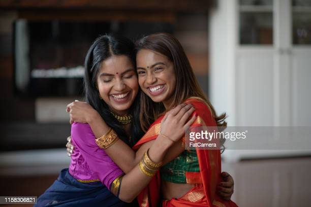 two (2) happy and attractive indian sisters - sister stock pictures, royalty-free photos & images