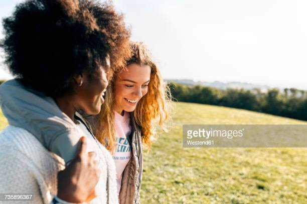 two happy best friends outdoors - arm around stock pictures, royalty-free photos & images