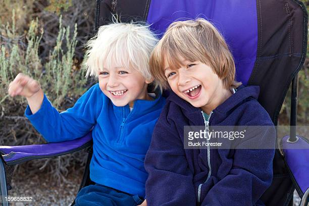 Two Happy Boys In Camp Chair