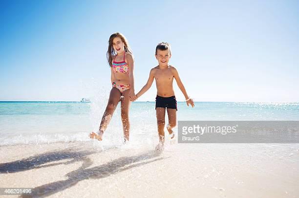 Two happy children having fun on the beach.