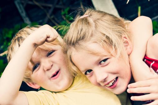 Two happy children play fighting - gettyimageskorea