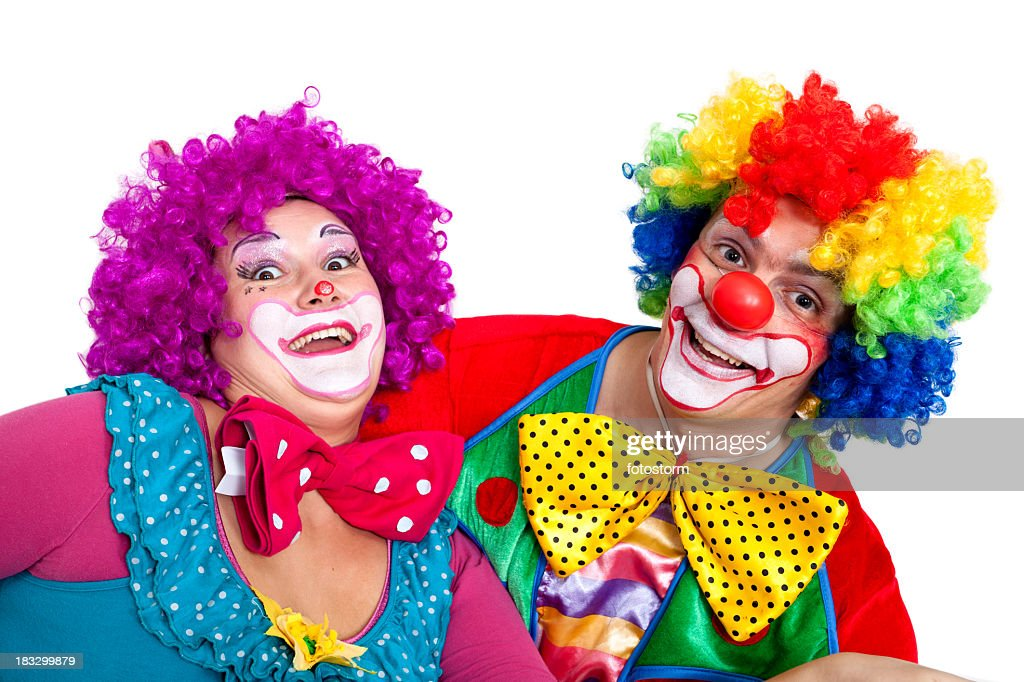 Two happy clowns making faces on white background : Stock Photo