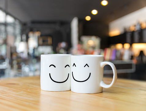 Two happy cups on coffee store blur background, Valentine lover concept 843265624