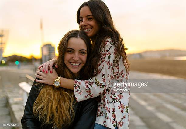 Two happy female friends having fun together