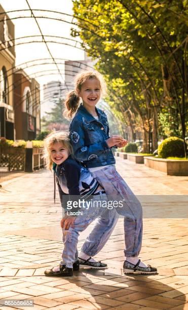 Two happy girls outside