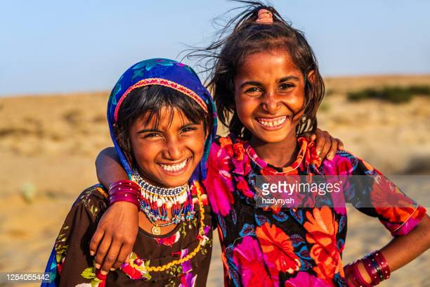 two happy gypsy indian girls, desert village, india - south asia stock pictures, royalty-free photos & images