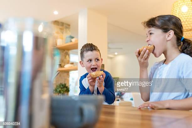 Two happy kids having healthy breakfast