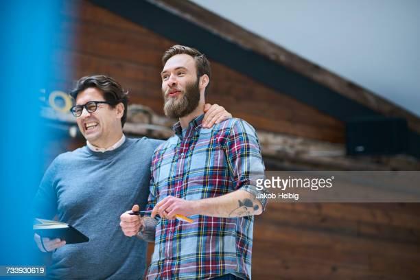 Two happy male designers in design studio