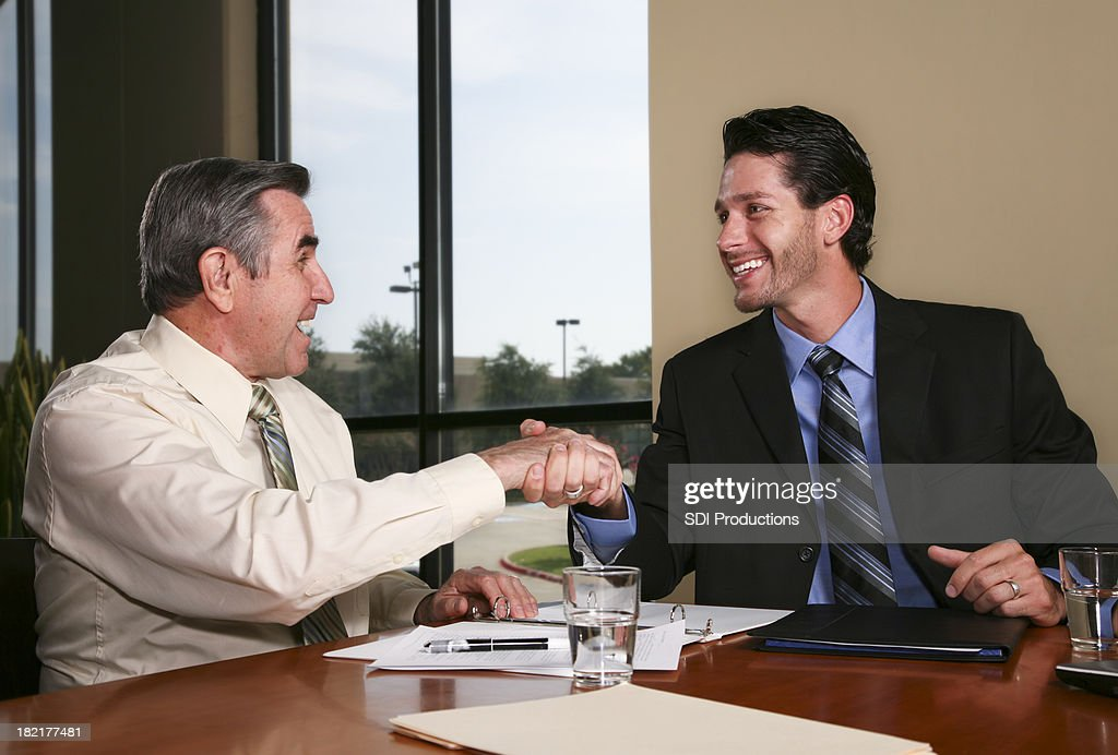 Two happy men making a deal : Stock Photo