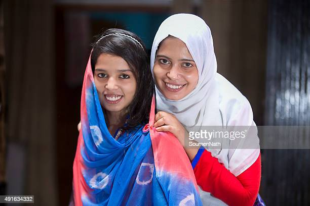 Two Happy Muslim women with traditional veil