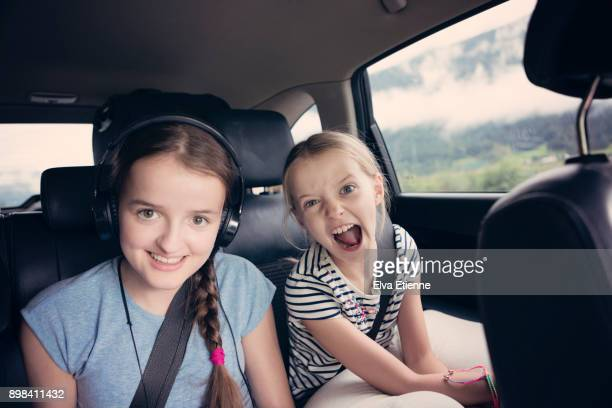 Two happy sisters on a road trip