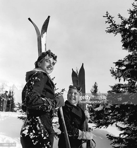 Two happy skiers, 1936 in Megeve, France.