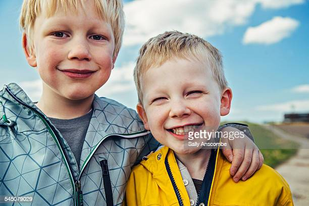 two happy smiling little boys outdoors - brother stock pictures, royalty-free photos & images