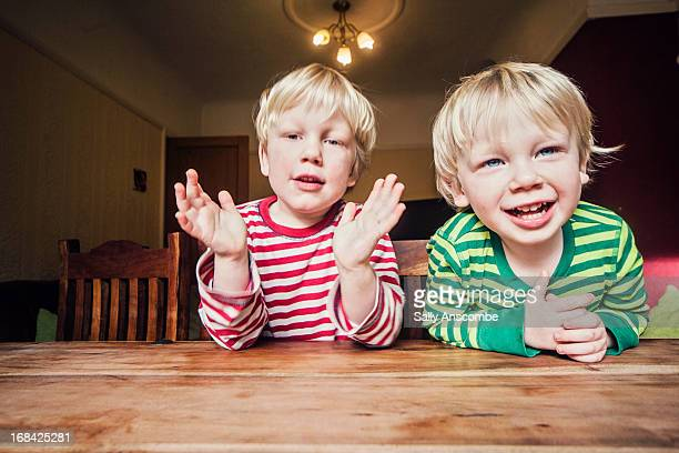 two happy smiling little boys - clap stock pictures, royalty-free photos & images
