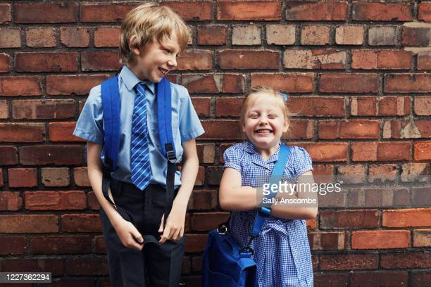two happy smiling school children - education stock pictures, royalty-free photos & images