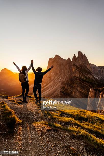two happy tourists greetings sunrise in mountains - mountain ridge stock pictures, royalty-free photos & images