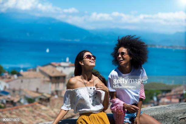 two happy woman friends laughing - italian women stock photos and pictures