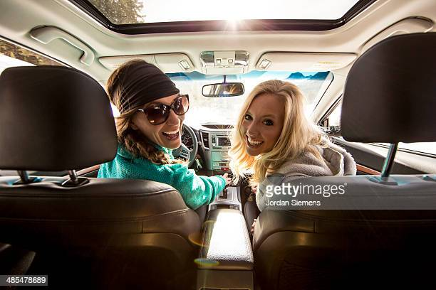 Two happy women in a car.