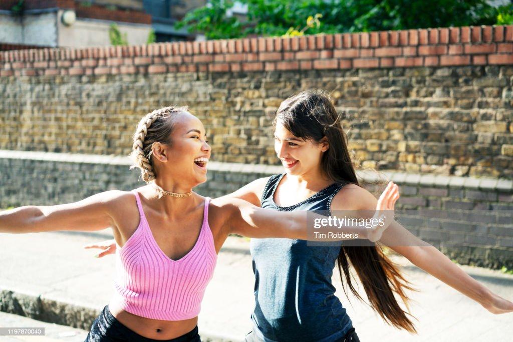 Two happy women messing about : Stock Photo