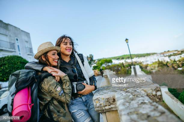 Two happy young women on a trip