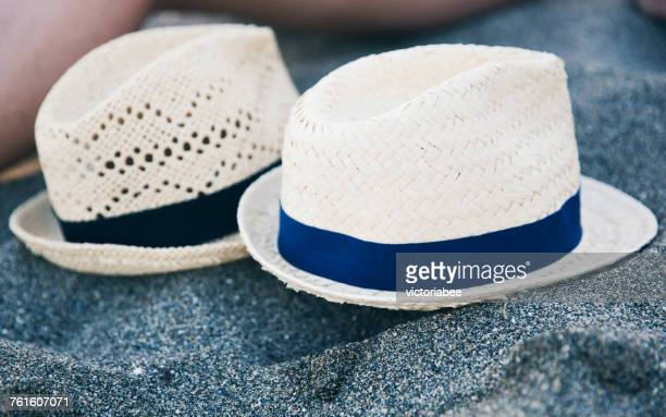Two hats on a rock