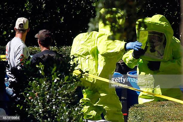 Two hazmat workers prepare to reenter The Village Bend East apartment where a second health care worker who has tested positive for the Ebola virus...