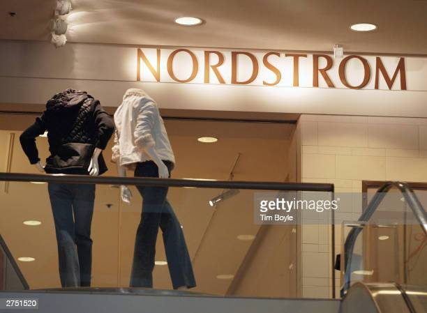 Two headless mannequins are seen near Nordstrom signage at its store November 21 2003 in Chicago Nordstrom Inc reported net earnings of $455 million...