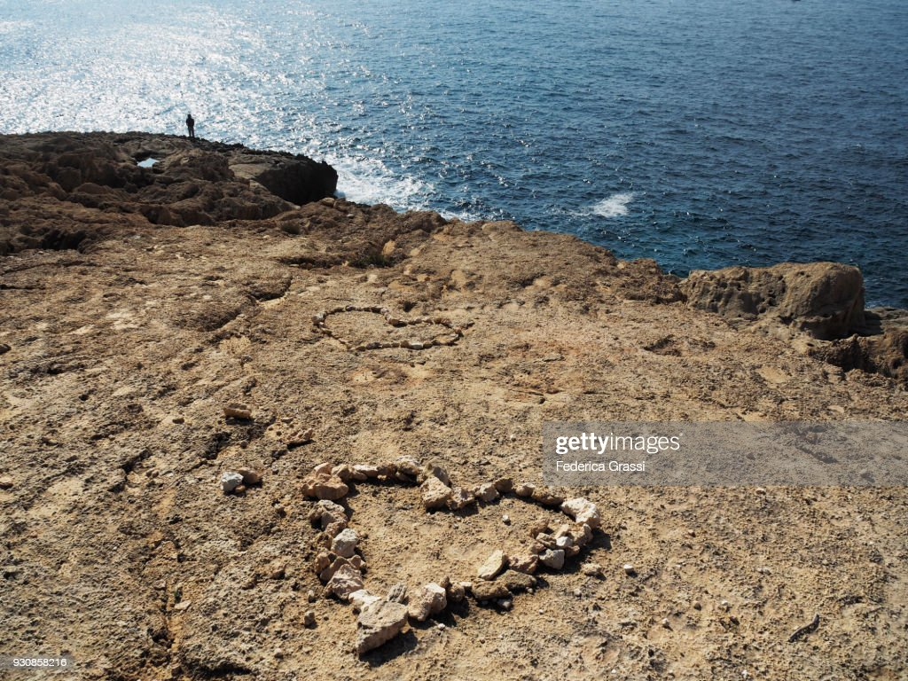 Two Heart Shaped Compositions Made With Stones On Atlantis Beach, Ibiza : Stock Photo