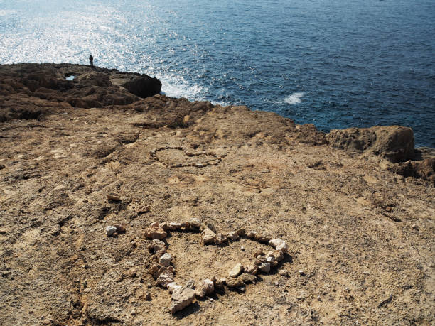 Two Heart Shaped Compositions Made With Stones On Atlantis Beach, Ibiza