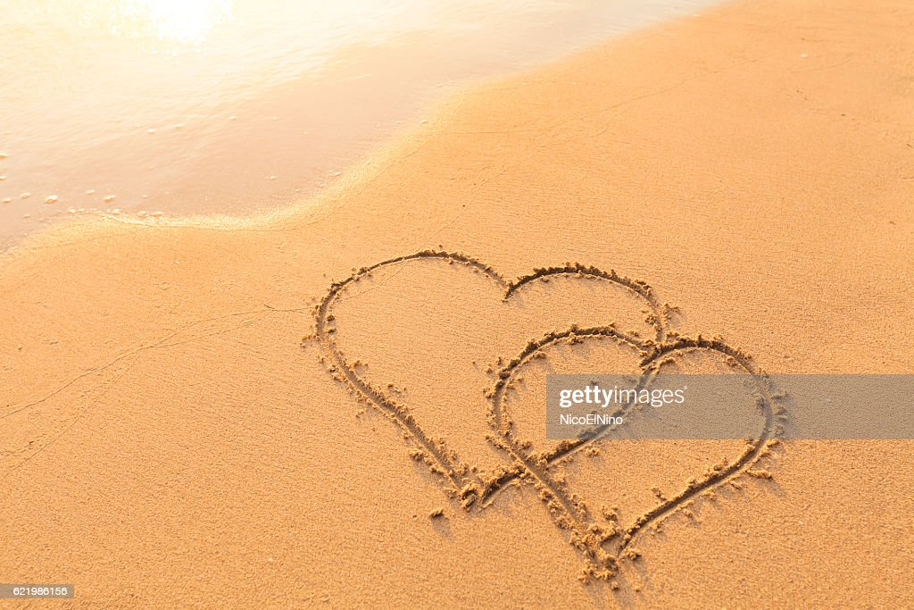 Two Hearts Drawn In The Sand Symbol Of Love Honeymoon Stock Photo