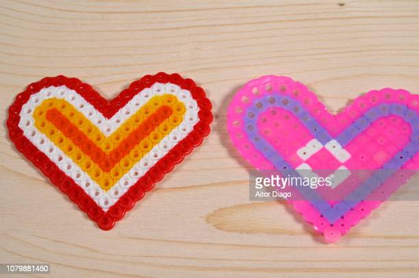 Two hearts on a wooden surface. Handmade hearts.