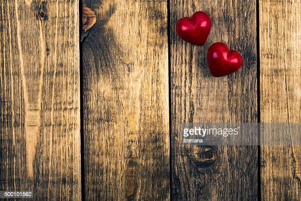 Two hearts on rustic wooden board, Valentines day background, top view